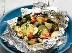 Zucchini and Tomatoes (throw some squash in there too!) ..Toss 2 sliced zucchini, 2 diced tomatoes, 4 smashed garlic cloves, olive oil, basil, and salt and pepper on a sheet of foil. Form a packet. Grill over high heat, 10 minutes. Top with grated Parmesan.