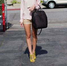 mustard shoes. beige shorts. black bag