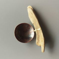 Copper spoon with drift wood.