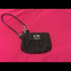 Authentic Coach Wristlet Small, lightly used, authentic black Coach Wristlet. Outside is in fantastic condition! Looks brand new. Inside does have some signs of wear (as shown in photo). Perfect for cell phones, a license, some money, lipstick, etc for a fun night out! Please let me know if you have any questions or would like to see additional photos! Coach Bags Clutches & Wristlets