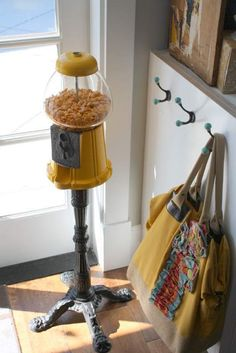 Old gumball machine filled with goldfish snacks.