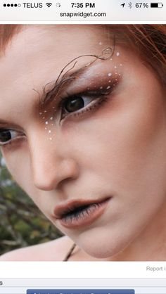 Earth goddess: Makeup, twigged brows, auburn shadow, white fawn dots extending to cheekbones.
