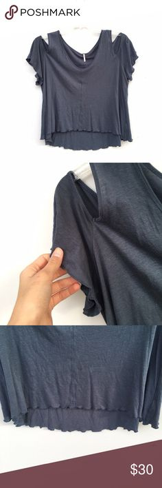 Free People NWOT Blue Cold Shoulder Top Gorgeous Free People cold shoulder top in a unique dark blue color. Never worn, NWOT. However, has three very small pinprick holes in the front, as shown. Hemming is slightly ruffle like. Free People Tops Tees - Short Sleeve
