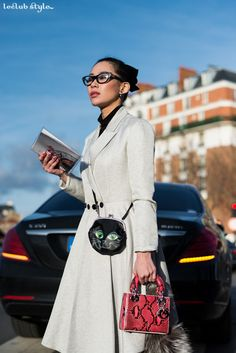 Womenswear Street Style by Ángel Robles. Fashion Photography from Paris Fashion Week. Ladylike outfit with cat-eye glasses and Lady Dior bag to attend Dior Men's fashion show, Paris.
