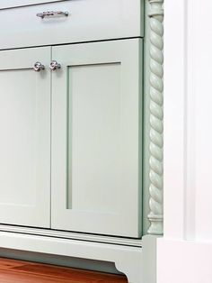 Custom Built-In  Simple recessed-panel doors convey classic cottage style, while curvy feet, rope columns, and beaded edging add fine-furniture touches to the hutchlike built-in.