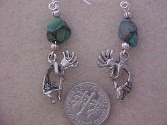 Kokopelli Silver Charm Earrings with Greenish Turquoise Nugget and Silver Beads on Etsy, $9.95