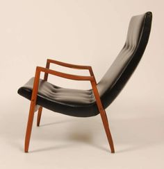 Milo Baughman; Walnut and Leather 'Scoop' Lounge Chair for Thayer Coggin, 1950s.