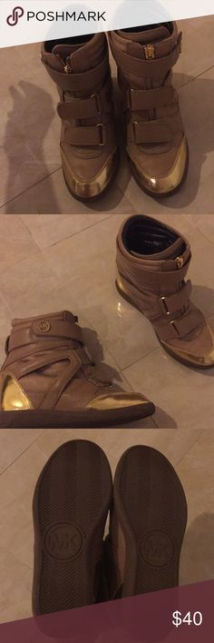 NWOT MICHAEL KORS HIGH TOPS Michael Kors Hightop Wedge Sneakers.  NWOT. Excellent condition. No signs of damage or wear.  Soles are intact and clean. Michael Kors Shoes Ankle Boots & Booties