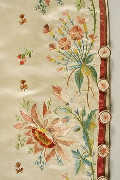 Detail waistcoat, 3-piece court suit, France, 1774-1793. Brown patterned silk velvet richely embroidered with nanturalistic floral motifs in multicoloured silk; waistcoat: cream silk satin, front panels embroidered allover with small flower sprays, front borders embroidered with naturalistic floral motifs.