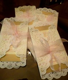 Doilies wrapped around invitation makes it look so classy