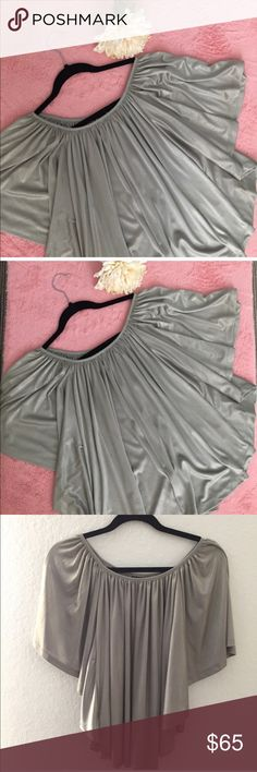 SILVER TUNIC TOP NWOT Beautiful Silver Poncho Blouse. 💗Condition: NWOT. No flaws. no rips, holes or stains 💗Smoke free home 💗No trades, No returns 💗No modeling  💗Shipping next day 💗OPEN TO reasonable OFFERS  💗BUNDLE and save more 💗All transactions video recorded to ensure quality. Macy's Tops Tunics