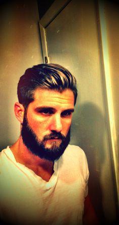 Modern men's hair cut. Undercut longer on top. Men with beards.
