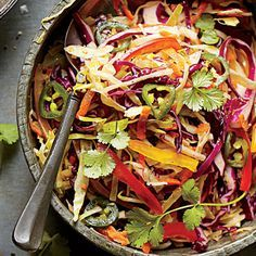 Central Texas Slaw - white vinegar, evoo, sugar, lime juice, salt, corriander, cumin, red pepper, black pepper, red cabbage, white cabbage, carrots, red bell pepper, yellow bell pepper, jalapeno pepper Coleslaw Recipes - Southern Living