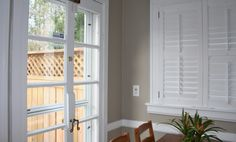 Benjamin Moore Pashmina is a beautiful greige paint colour, in between gray and beige. Shown with white shutters and french doors by Color Forte