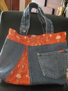 Tina Givens purse.  Tangerine chandelier denim bag.  Upcycled jeans handbag.  With matching makeup bag.  HANDMADE.. $50.00, via Etsy.
