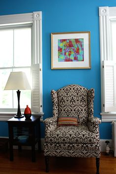"Sneak Peek: A Massachusetts Farmhouse Where Color and Pattern Meet. ""The ladies wingback chair in our den belonged to my grandmother.  I had it reupholstered with a linen/velvet fabric. The artwork hanging above the chair is by another friend and artist, Sean Greene.  This is actually a print of the original painting which measures an impressive 48 x 54 inches."" #sneakpeek"