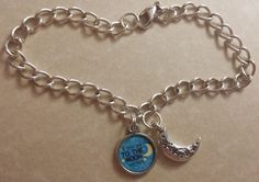 "Handmade ""I love you to the Moon and back"" Charm Bracelet with Moon Charm Can make in any color of your choice (shown or contact for a different color). Blue, pink, purple, orange, gray, etc. Bracelet measures 8.5 inches but can be shortened per request. Limited quantities."