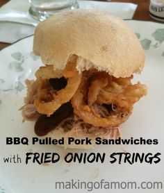 Try these easy slow cooker BBQ pulled pork sandwiches and add some kick with friend onion strings!