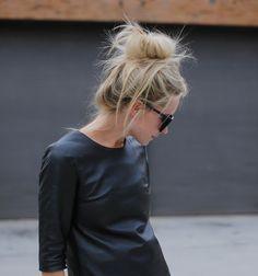 Dark shirt, sunglasses, messy bun