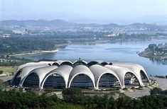 Rungrado May Day Stadium. Leading off the top 10 biggest stadiums in the world with a capacity of is the Rungrado May Day Stadium in Pyongyang, North Korea. Soccer Stadium, Football Stadiums, Bobsleigh, New Architecture, Futuristic Architecture, Stadium Architecture, Camp Nou, Mexico City, Temples