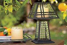Weathered Zinc Candle Lamp - Designed with optic-glass panels and weathered metal frame, our decorative lamp brings architectural grace to any space – indoors or out. Use with an Escential or GloLite jar, pillar candle or tealight, all sold separately.
