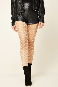 A pair of lightweight knit tights featuring a fishnet design and an elasticized waist.