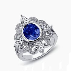DTLA Sterling Silver Sapphire Blue Oval Shape Signity Simulated CZ Ring