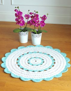Made by Henna at HandyCrafter.blogspot also at Henna's Boutique at Etsy. I like the look of the mixed colors.  This one is a smaller version of her rugs for a table.