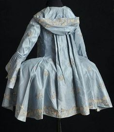 """Today's #georgianjanuary theme is """"Light Blue."""" This short sacque, held in Textil Museet, Borås, Sweden, is curious because it seems to be completely mis-dated at 1790, but side hoops were way out of fashion by then. The design, styling, and textile is much closer to 1760s."""