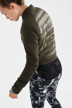 Camo leggings and a moto jacket add edge to the everyday. Say whatever to winter with more innovative warmth in the Nike Women Holiday 2015 Style Guide.