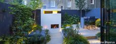 Wonderful use of colour to create a glamourous courtyard space #courtyard #london #fireplace