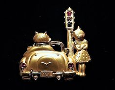 ITEM # 101626  Vintage signed JJ for Jonette Jewelry, COOL cat brooch. Male cat driving a cool car, sitting at the stoplight, checking out the female on the corner. The cars taillights have red rhinestones and the stoplight has red, yellow and green rhinestone. Brooch set in a matte goldtone metal, high polish on males scarf and car bumper.  Very good vintage condition with typical wear due to age and handling. Please visit my other Etsy shop for antique & vintage porcelain at…