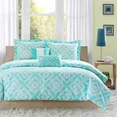 The teal and white geometric square print on the Natalie comforter set will create a fun youthful look in your bedroom. This comforter's reverse features a solid teal finish. Made from 100-percent polyester, this set is machine washable for easy care.