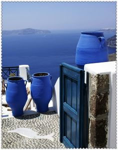 Aegean Sea blue.  Love the stone paving