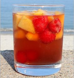 Carolina-Peach-Sangria...1 (750 ml) bottle rose wine   3/4 cup peach or raspberry vodka   1/3 cup thawed frozen lemonade concentrate   2 Tablespoons granulated white sugar, or more- to taste   3 large ripe peaches, peeled and diced   1 1/2 cups fresh raspberries   2 cups club soda, chilled