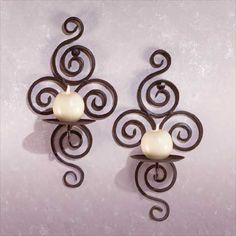 swirling and whirling with an unconventional harmony, this is one twisted, yet lovely, set of wrought iron candle holders! Candles not included. Living Room Candles, Sconces Living Room, Wall Candle Holders, Candle Wall Sconces, Candle Stands, Iron Furniture, Outdoor Wall Sconce, Wrought Iron, Candlesticks