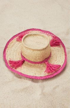 A quartet of bright tassels adds a saucy flourish to this breezy woven hat. Perfect for summer!