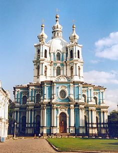 Smolny Cathedral, St. Petersburg - Russia - The dazzling cupolas of Smolny Cathedral, one of the most beautiful churches in St. Petersburg, rise majestically from its waterside location on the banks of the Neva River. Smolny Cathedral was designed by Italian architect Bartolomeo Rastrelli,
