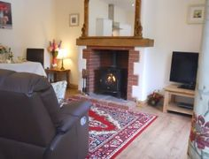 Open plan living area with cosy woodburner cornwall