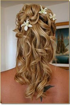 love the half updo with plumerias