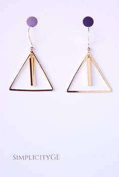Gold triangle earrings with simple bar pendants. Geometric earrings made with 14k gold filled ear wires. Minimalist jewelry