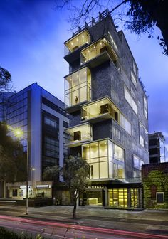 The Click Clack Hotel in Bogota, Colombia by plan:B Arquitectos and Perceptual Studio More about the Click Clack hotel and another architecture inspiration on WE AND THE. Commercial Architecture, Facade Architecture, Residential Architecture, Amazing Architecture, Building Exterior, Building Facade, Building Design, Design Exterior, Facade Design