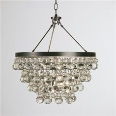 """Deco Glam Chandelier  Go bold with glamour! With Art Deco elegance, this collection features layers of fabulous crystal pears and balls with brilliant metals. These pieces are updated and ready to add glamour to any room in the house! Minor assembly required. Specify Bronze or Polished Nickel hardware. 4x60 watts (medium base bulb). (21""""Hx21""""W). Comes with 3' Chain. Glass Drops. Canopy can be mounted directly to ceiling to be hung as a semi-flush ceiling light. Crystal assembly required"""