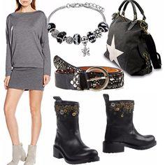 Mini abito in lana indossato con una cintura borchiata sui fianchi e biker boot neri con inserti metallizzati. Sempre nera la borsa a mano con applicazione argento.