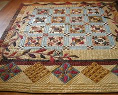 tan and blue quilt with owl sitting on branch - the pale blue really pops