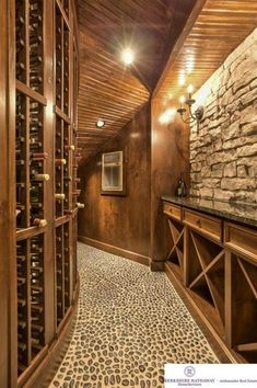 Contemporary Wine Cellar with sandstone floors, Exposed beam, Wall sconce, Built-in bookshelf