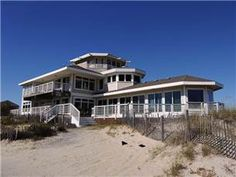 3.5 bth (3Q,,2S,P) Located on a high dune, this home boasts spectacular ocean and sound views from every room.  This home highlights the natural ...