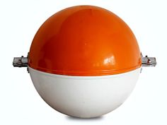 The picture shows an orange/white obstruction marking sphere with two clamps.