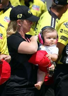 May 19, 2012; Indianapolis, IN, USA; IndyCar owner Sarah Fisher holds her daughter Zoe during qualifications for the Indianapolis 500 at the Indianapolis Motor Speedway. Mandatory Credit: Brian Spurlock-US PRESSWIRE #Indycar
