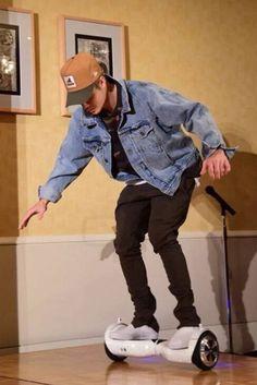 Justin Bieber wearing Wizboard Rokaway, Vans Classic Perforated Slip-On Sneaker , Fear of God Denim Raglan Trucker Romper Jacket, New Era XLarge Patch D-Frame Trucker Cap